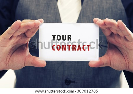 Executive Holding card with Message Saying-Your Contract - stock photo