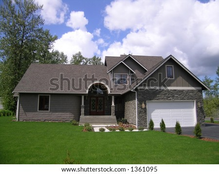 Executive Home with Lush Green Lawn - stock photo