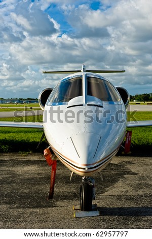 Executive jet in tarmac in regional airport - stock photo