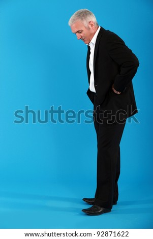 Executive looking at the floor - stock photo