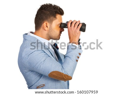 Executive man looking through binocular isolated on white background - stock photo