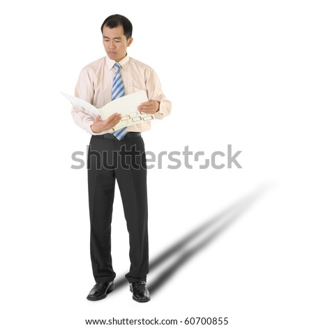Executive reading report, full length portrait isolated on white. - stock photo