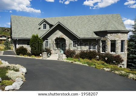 executive style grey home on a hill - stock photo
