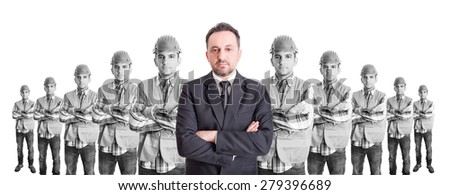 Executive suited manager leader of builders team. Leader, boss or head concept. - stock photo