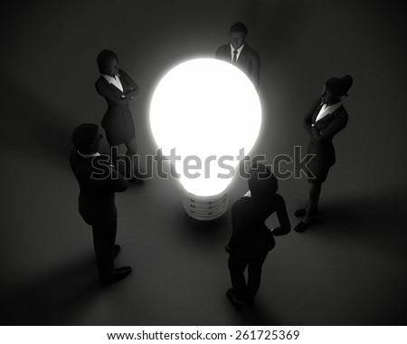 Executive team around light bulb of ideas. An executive team surrounds a glowing lighbulb representing a source of great ideas. - stock photo