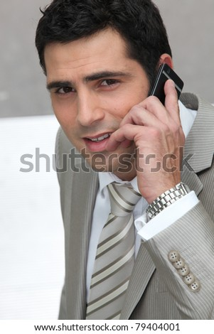 Executive using a cellphone - stock photo