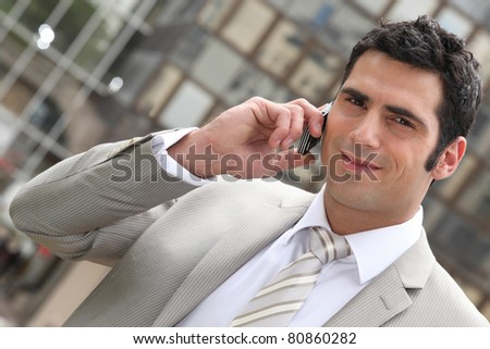 Executive using a cellphone - stock photo