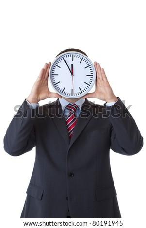 Executive with clock in front of face as a sign of stress.Isolated on white background.