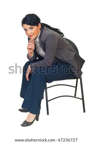 Executive woman sitting on chair and looking at camera smiling isolated on white background