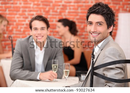 Executives celebrating with champagne. - stock photo