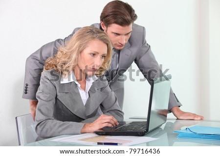 Executives with laptop computer - stock photo