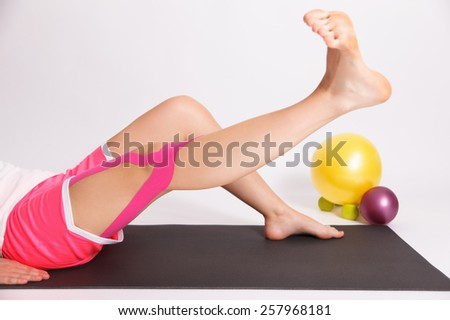 Exercise after leg injury with kinesiology tape - stock photo