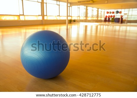 exercise ball for fitness on wooden floor
