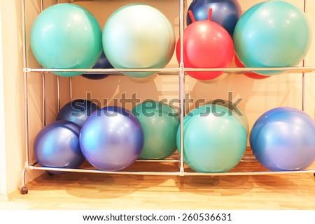 Exercise balls in fitness center - stock photo