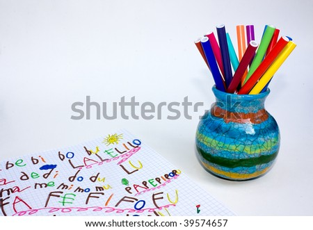exercise book and ceramic pot with set of colored felt-pen - empty space for text