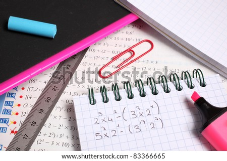 exercise book and school supplies - stock photo