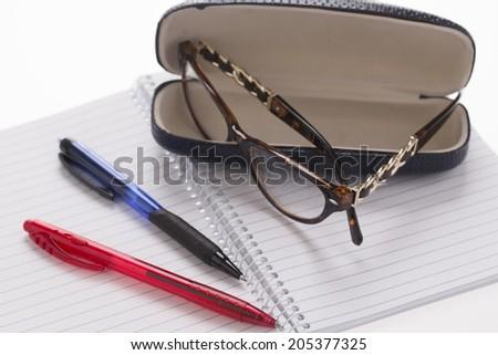exercise books, pens, glasses for the start of school - stock photo