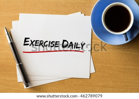 Exercise daily - handwriting on papers with cup of coffee and pen, health concept