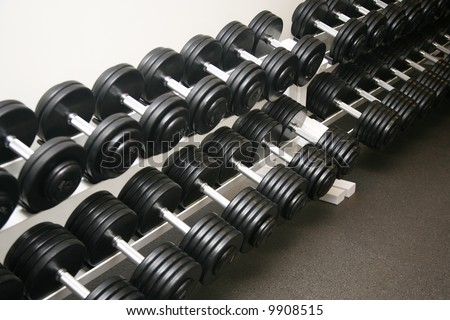Exercise equipment neatly stored in a police gym - stock photo