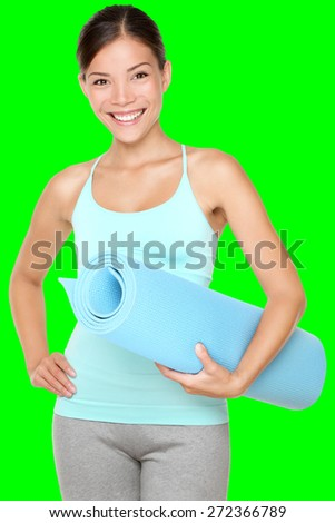 exercise fitness woman ready for workout standing holding yoga matisolated cutout on green chroma key background. Sporty fit and fresh mixed race Chinese Asian / Caucasian female fitness model.