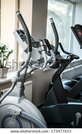 Exercise machines in a fitness club - stock photo