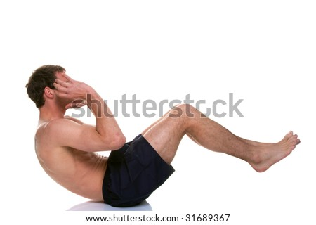 Exercise shot of a man doing a sit up stomach crunch, isolated on a white background. - stock photo