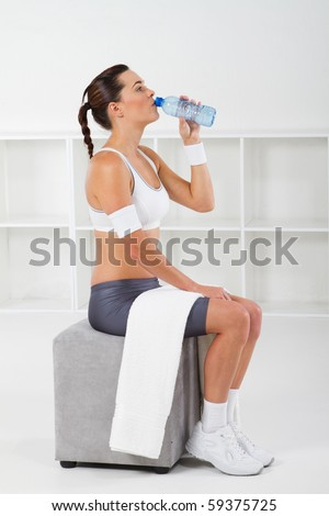 exercise woman drinking water after workout - stock photo