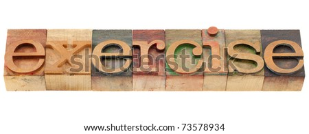exercise word in vintage wood letterpress printing blocks, isolated on white