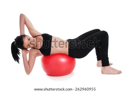 Exercises for stomach's muscle, woman stretching above a gymnastic ball - stock photo