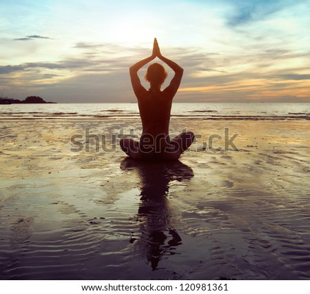 exercises on the beach - stock photo