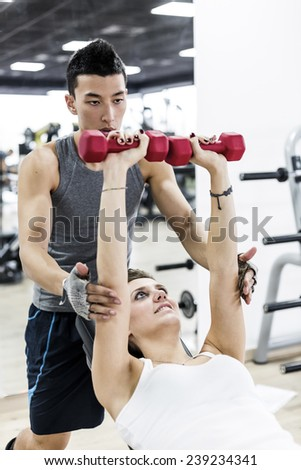 Exercises with Personal trainer in Health Club. - stock photo