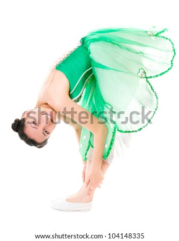 Exercising cheerful ballerina in green dress isolated on white background - stock photo