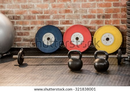 Exercising equipment arranged at the gym - stock photo