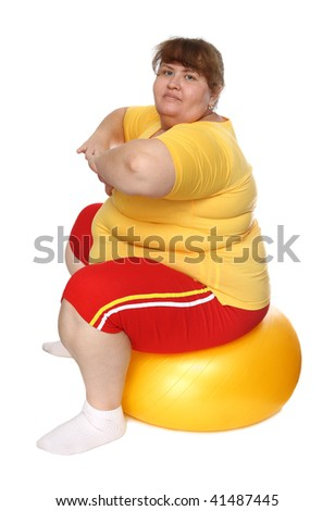 exercising overweight woman on ball isolated on white - stock photo