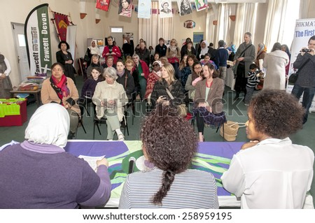 EXETER, ENGLAND - MARCH 7, 2015: The speakers address the audience at the Mosque during the Walk for Peace through the city of Exeter to celebrate International Women's Day. - stock photo