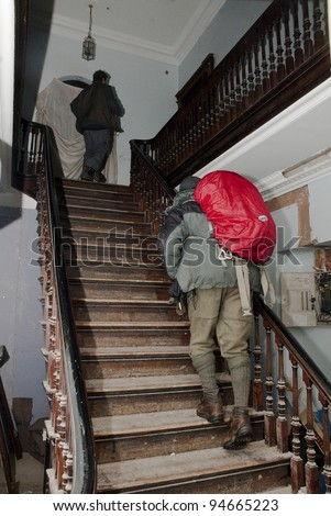 EXETER - FEBRUARY 4: Occupy Exeter activists walking on the stairs of Occupy Exeter site 2 on February 4, 2012 in Exeter, UK - stock photo