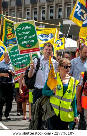 EXETER - JULY 10: PCS members with placards walk along Exeter High Street during the public sector workers national day of action in Exeter City Centre on July 10,  2014 in Exeter, Devon, UK - stock photo
