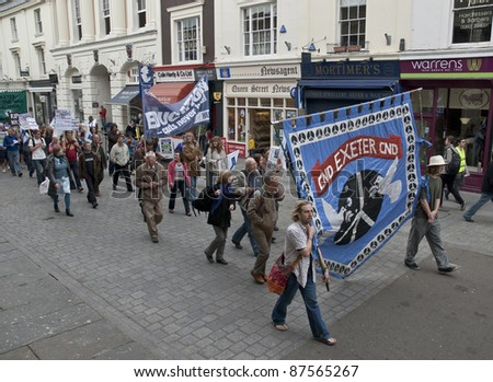 EXETER - MAY 2:  Organisations and Trade Unions marching on the streets of Exeter City as part of the May Day demonstration against the coalition governments spending cuts  on May 2, 2011 in Exeter. - stock photo