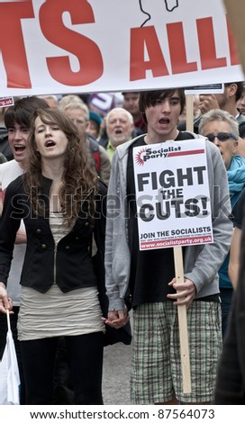 EXETER - MAY 2:  The young, hand in hand, marching on the streets of Exeter City as part of the May Day demonstration against the coalition governments spending cuts  on May 2, 2011 in Exeter.