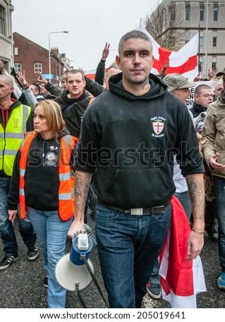 EXETER, UK - NOVEMBER 16: English Defence League Exeter branch leader Kieran Hallett leads the line during the English Defence League march and rally November 16, 2013 in Exeter, Devon, UK - stock photo