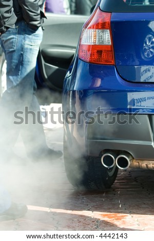 Exhaust pipe and waste gases. - stock photo