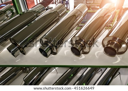 exhaust pipe for motor sports  at  car shop . - stock photo