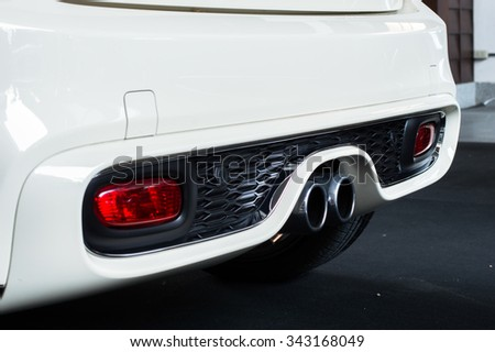 Exhaust pipe of a car - stock photo