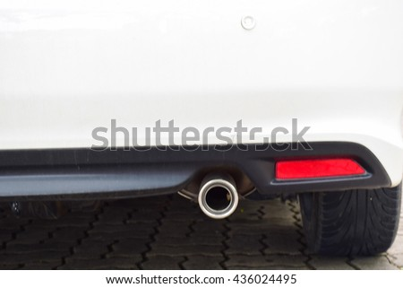 Exhaust pipe of a car, concern about environment problem - stock photo