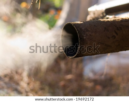 Exhaust pipe of the car old - stock photo