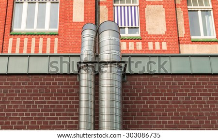 Exhaust pipes of metal of an old factory of bricks - stock photo
