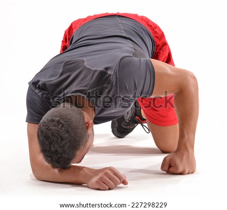 Exhausted athletic man on white background. - stock photo