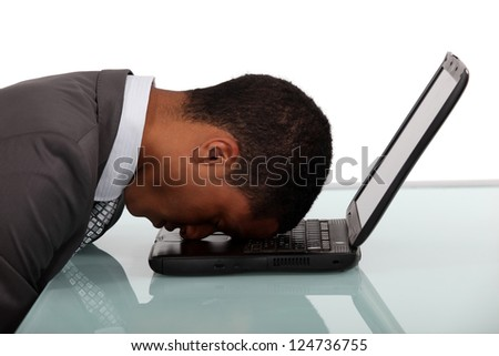 exhausted businessman sleeping over his laptop - stock photo