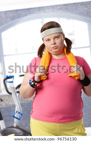 Exhausted fat woman after workout at the gym.? - stock photo
