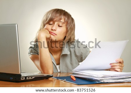 Exhausted female  at her desk. Isolated